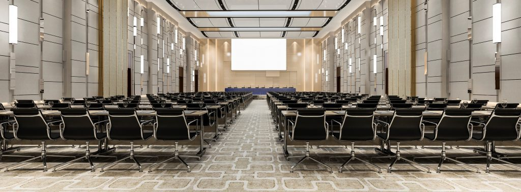 large, empty conference room with many rows of seats