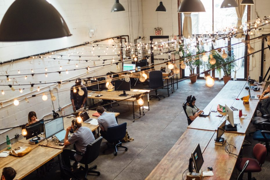 People working on laptops in co-working space